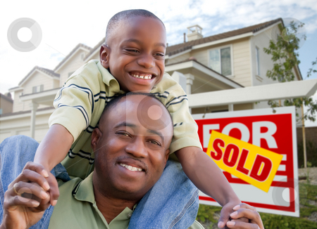 Father and Son In Front of Real Estate Sign and Home stock photo, Happy African American Father and Son in Front of New Home and Real Estate Sign. by Andy Dean