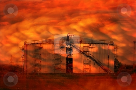 Apocalypse stock photo, Oil silo and sky and landscape blazing in flames by P?