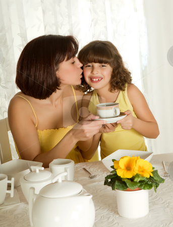 Coffee for mother's day stock photo, Little girl serving coffee for mother's day breakfast by Anneke