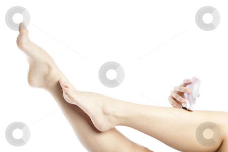 Leg depilation stock photo, Woman doing depilation on her leg with electric epilator by Igor Petrovi?