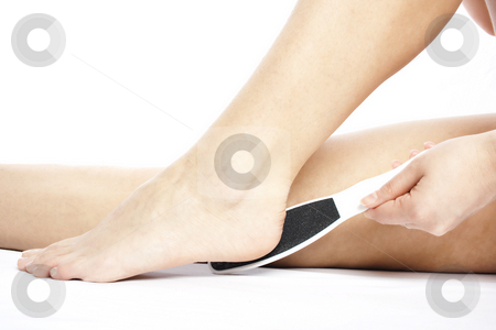 Heel scrubing stock photo, Woman scrubs her heel by Igor Petrovi?