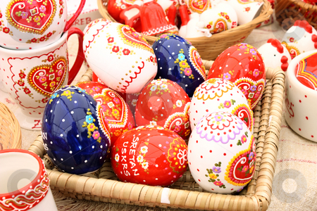 Painted eggs stock photo, Basket full of painted eggs before easter by Borislav Marinic
