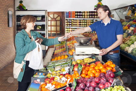 At the Greengrocer stock photo, Woman shopping for fresh food and vegetables at a greengrocers' market by Corepics VOF
