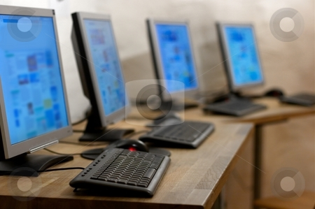 Computers stock photo, Four computer in a row in an office or internet cafe by P?