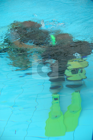 The first dive stock photo, A instructor is traning a student how to dive by Lars Christensen