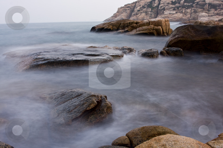 Rock coast background stock photo, Long exposure of rock coast background by Keng po Leung