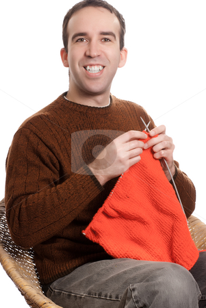 Happy Knitting Man stock photo, A happy man is knitting something while sitting down, isolated against a white background by Richard Nelson