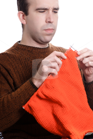 Knitting stock photo, A young man is knitting something while sitting down, isolated against a white background by Richard Nelson