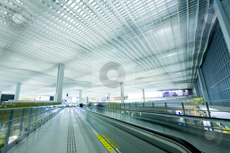 Airport stock photo, China; Hong Kong international airport main hall; the words in the label is be care of children by Keng po Leung