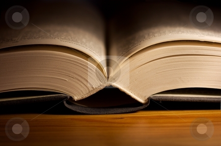 Book stock photo, Open book on a table with narrow DoF by P?