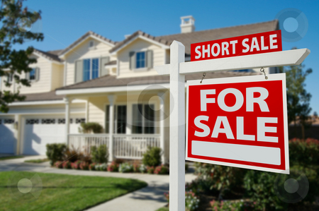 Short Sale Real Estate Sign and House stock photo, Short Sale Home For Sale Real Estate Sign in Front of New House. by Andy Dean