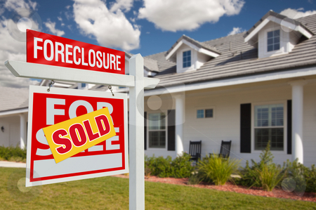Sold Foreclosure Real Estate Sign and House - Left stock photo, Sold Foreclosure Home For Sale Real Estate Sign in Front of New House - Left Facing. by Andy Dean