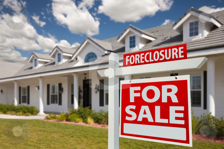 Foreclosure Real Estate Sign and House - Right stock photo, Foreclosure Home For Sale Real Estate Sign in Front of New House - Right Facing. by Andy Dean