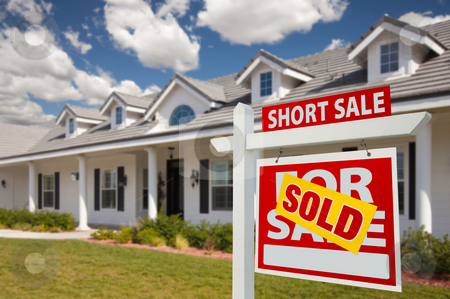 Sold Short Sale Real Estate Sign and House - Right stock photo, Sold Short Sale Home For Sale Real Estate Sign in Front of New House - Right Facing. by Andy Dean