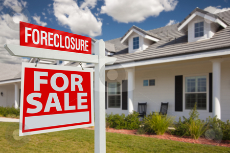 Foreclosure Real Estate Sign and House - Left stock photo, Foreclosure Home For Sale Real Estate Sign in Front of New House - Left Facing. by Andy Dean