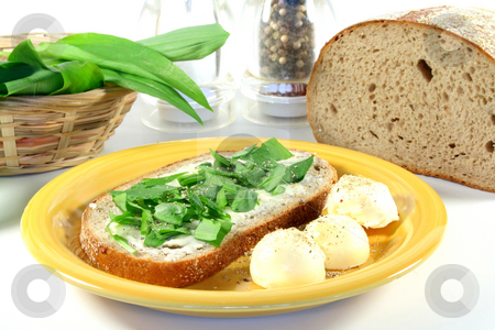 Wild Garlic Bread stock photo, A slice of buttered bread with freshly chopped wild garlic by Simone Voigt
