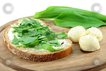 Wild Garlic Bread stock photo, A slice of buttered bread with freshly ...