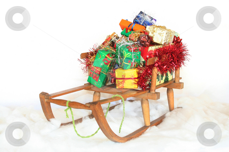 Christmas gifts stock photo, Sled in the snow with Christmas gifts on a white background by Marén Wischnewski