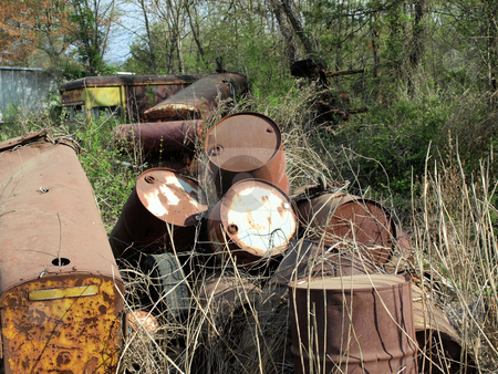 Industrial junk stock photo, Aold oil barrels abandoned on a rural farm by Tim Markley