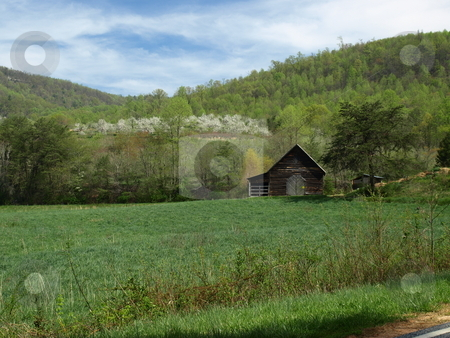 Spring i the mountains stock photo, Small barn in a rural field by Tim Markley