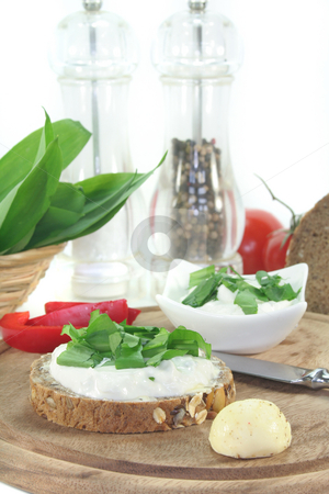 Cottage cheese bread with wild garlic stock photo, A slice of bread with cottage cheese and freshly chopped wild garlic by Marén Wischnewski