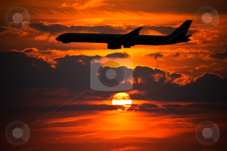Plane Silhouette against Setting Sun stock photo, Plane Silhouette against Setting Sun by Interlight
