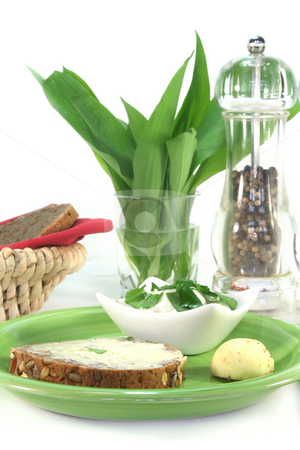 Wild garlic curd stock photo, A slice of bread with wild garlic curd by Simone Voigt