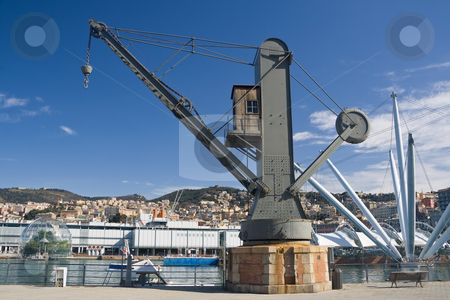 Genova , old port crane stock photo, the port of Genoa with on ald crane on foreground by ANTONIO SCARPI