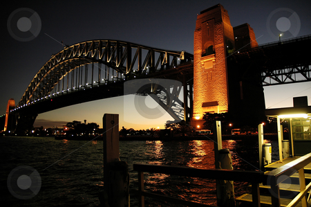 Harbour Bridge stock photo, Harbour Bridge in Sydney; night scene; wooden wharf in foreground by Robert Remen