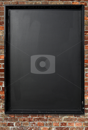 Blank blackboard menu sign on a red brick wall. stock photo, Blank blackboard menu sign on a red brick wall. by Stephen Rees