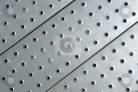 Metal plate floor close up. stock photo, Metal plate floor close up. by Stephen Rees