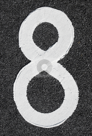 White number eight on asphalt. stock photo, White number eight on asphalt. by Stephen Rees
