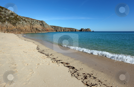 Porthcurno sandy beach shore line and Logan rock in Cornwall UK. stock photo, Porthcurno sandy beach shore line and Logan rock in Cornwall UK. by Stephen Rees
