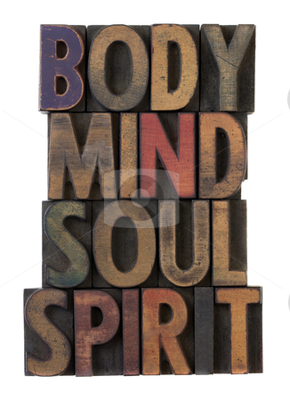 Body, mind, soul, spirit in old wood type stock photo, Body, mind, soul, spirit in vintage wooden letterpress types, stained by ink in different colors, isolated on white by Marek Uliasz
