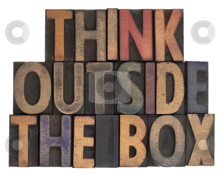 Think outside the box in vintage wood type stock photo, Think outside the box phrase in vintage wooden letterpress type, stained by ink, isolated on white by Marek Uliasz