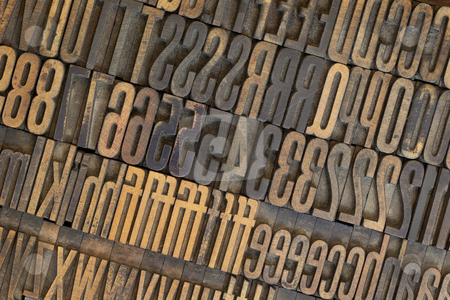 Vintage wooden letterpress types background stock photo, Vintage well used wooden letterpress types, letters and numbers  (Gothic condensed), stained in ink by Marek Uliasz