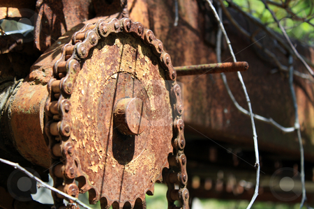 Old Farm Sorting  stock photo, Close-up of an old, rusted gear and chain outdoors by Carl Stewart