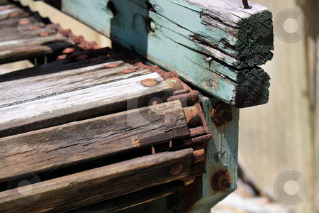 Old Farm Sorting  stock photo, Close-up of an old, rusted conveyor rack outdoors by Carl Stewart