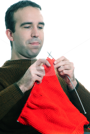 Man Knitting stock photo, Closeup view of a man knitting, isolated against a white background by Richard Nelson