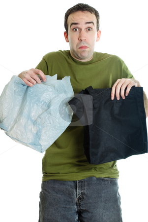 Cloth or Plastic Bags stock photo, A man trying to decide between cloth or plastic bags, isolated against a white background by Richard Nelson
