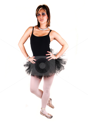 A young beautiful ballerina dancing. stock photo, An lovely, pretty young ballerina in a black twill dress with white pantyhose