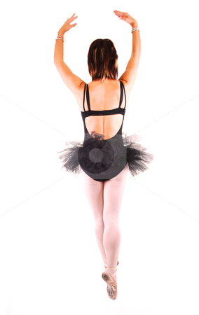 A young beautiful ballerina dancing. stock photo, An lovely, pretty young ballerina in a black twill dress with white pantyhose dancing in the studio for white background. by Horst Petzold