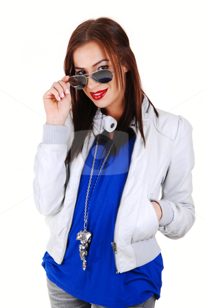 Girl with white jacket and sunglasses. stock photo, A young smiling woman in a blue sweater and light gray leather jacket pulling down her sunglasses, standing for white background. by Horst Petzold