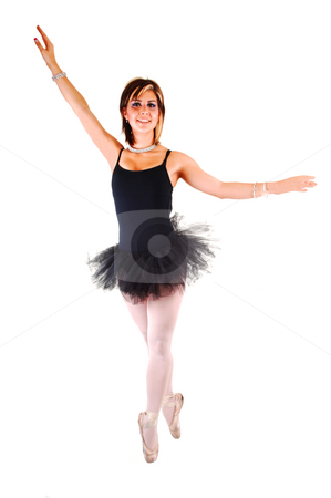 Beautiful young girl dancing ballet. stock photo, An lovely, pretty young ballerina in a black twill dress with white pantyhose dancing in the studio on her toe, for white background. by Horst Petzold