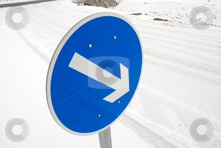 Arrow stock photo, Arrow traffic sign on a snowy road by P?
