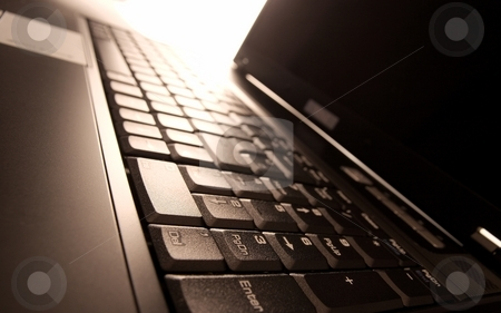 Laptop stock photo, Laptop with shiny light reflecting from the keyboard by P?