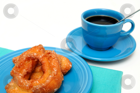 Buttermilk Donut And Coffee stock photo, Glazed buttermilk donut with a cup of black coffee served on turquoise colored plate, cup and napkin by Lynn Bendickson