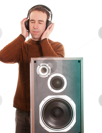 Listening To Music stock photo, A young man is listening to music with a pair of headphones, isoated against a white background by Richard Nelson