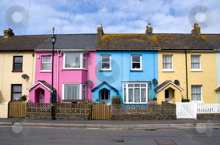 Row of brightly colored houses in a street  stock photo, Row of brightly colored houses in a street. All different colours. by Paul Phillips