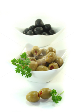 Olives stock photo, Black and green olives with parsley on a white background by Marén Wischnewski